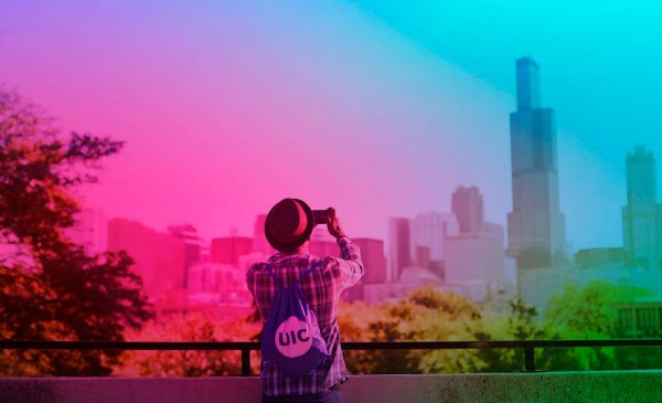 male student taking a photo of the Chicago skyline with a rainbow filter